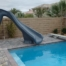 Custom Lap Pool And Spa With Slide And Diving Board
