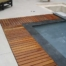 Travertine Deck With Zero Edge Teak Coping